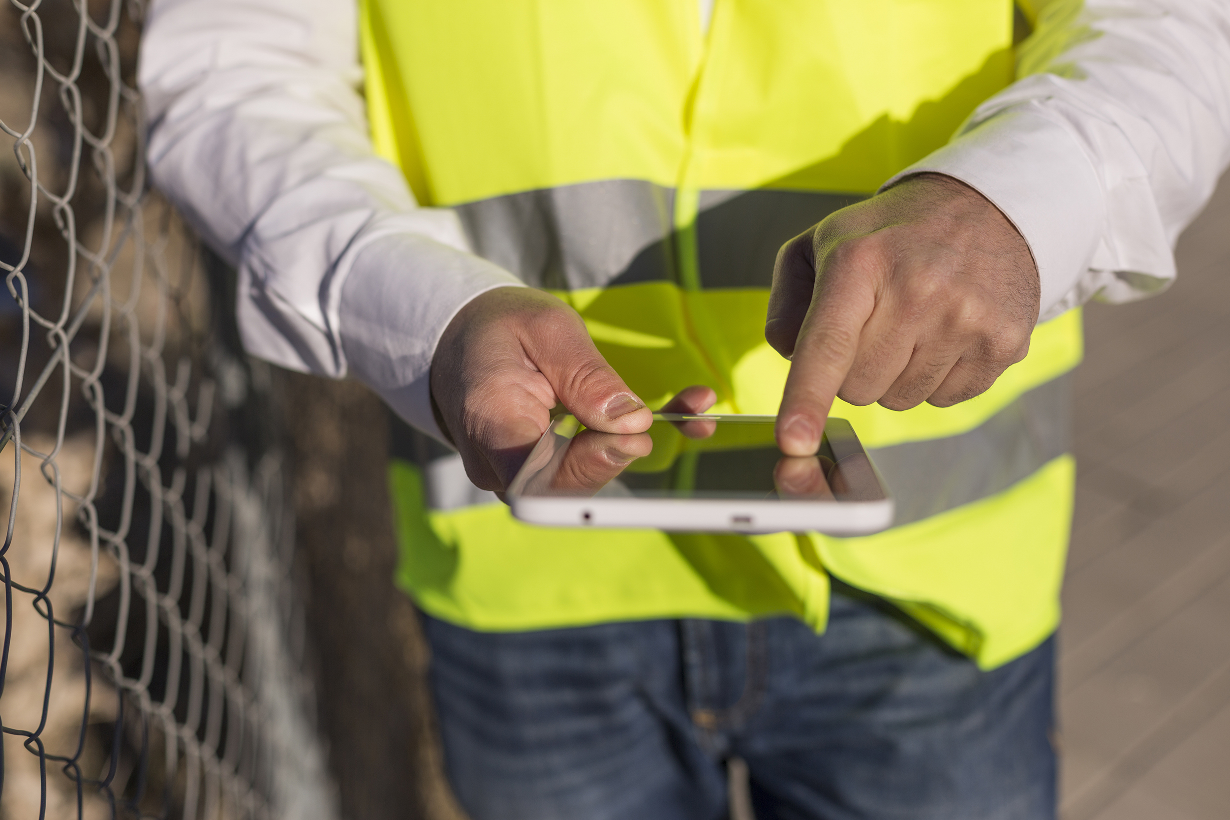 Field Engineer using mobile technology to